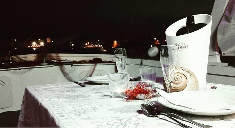 cena barca gita mare puglia